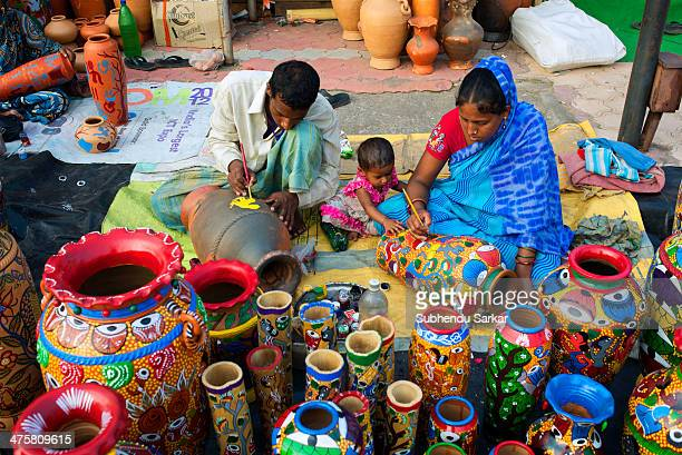 CONTENT] Husband and wife engaged in traditional pot painting in Kolkata India