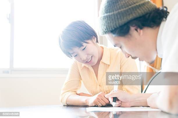 Husband and wife fill out important paperwork