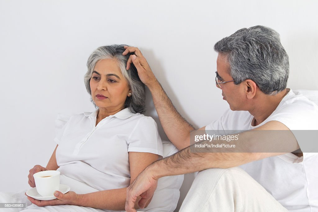 Husband and wife having tea : Stock Photo