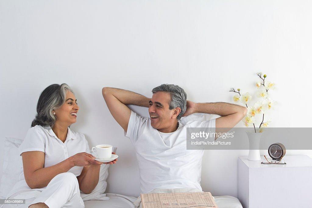 Husband and wife having tea : Stock Photo