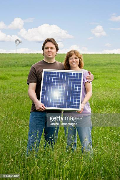 Husband and wife hold Solar Panel