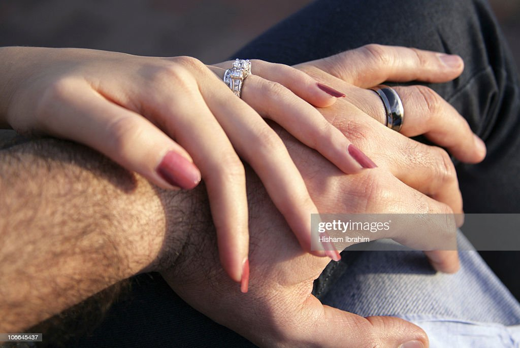 Husband And Wife Holding Hands Showing Rings Stock Photo Getty Images