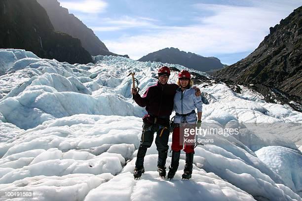 Husband and wife ice climbing on Fox Glacier NZ