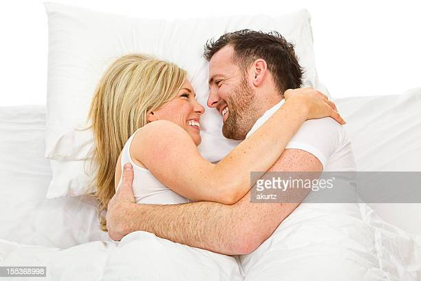 Husband and Wife in bed talking loving each other