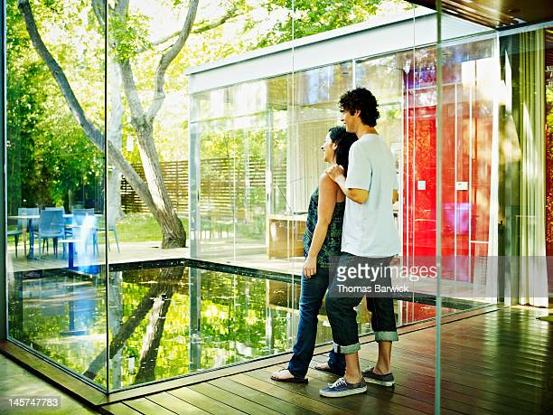 Husband and wife in hallway of contemporary home