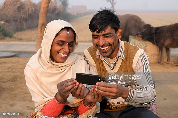 Husband and wife looking at smart phone