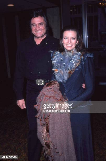 Husband and wife musicians Johnny Cash and June Carter Cash attends an event in May 1980 in Los Angeles California