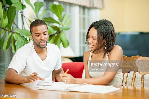 Husband and Wife Planning Their Budget
