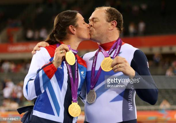 Husband and wife Sarah and Barney Storey pose with the medals they have won in the Track Cycling events on day 4 of the London 2012 Paralympic Games...
