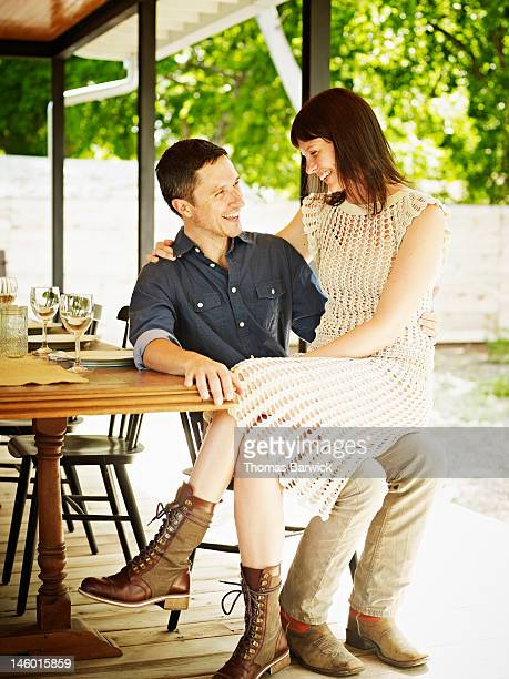 Husband and wife sitting together on chair