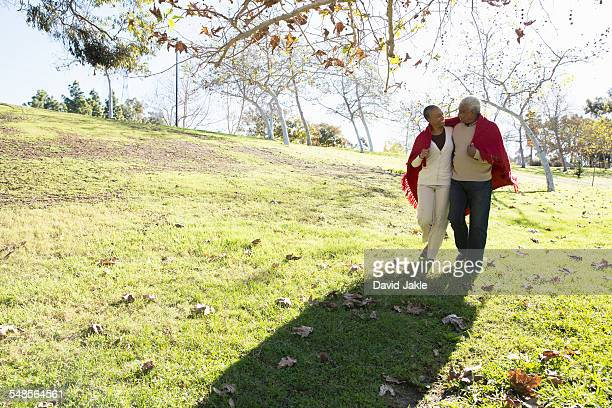 Husband and wife taking walk, Hahn Park, Los Angeles, California, USA