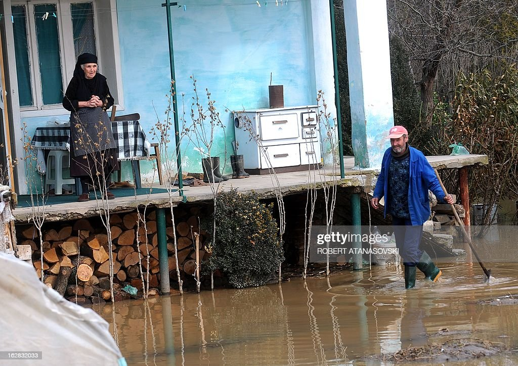 A husband and wife talk in front of their flooded house in the village of Monospitovo near the town of Strumica on February 28, 2013. The torrential rains which from Sunday until Tuesday poured down on the fertile Strumica Valley inundated fields and villages, destroying or damaging crops and households. Tens of people in the region are now sheltered, as their homes were gravely damaged. Other parts in Eastern Macedonia had their share of flooding in the first half of the week, which took one victim.