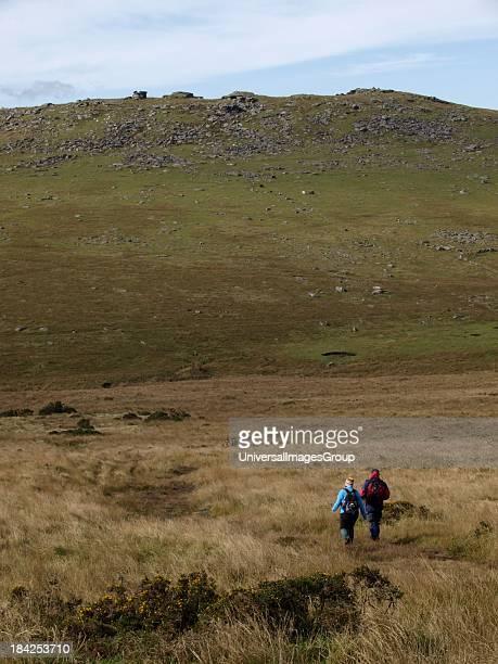Husband and wife walking on Bodmin Moor Cornwall UK