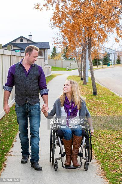 husband and wife with disability spending time together outdoors - paraplegic stock photos and pictures
