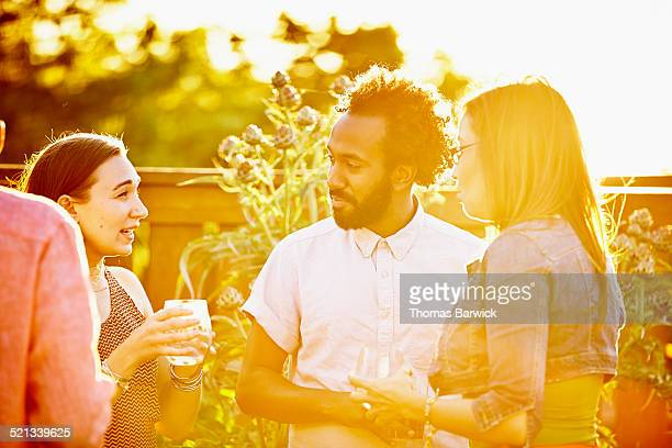 Husband and wife with friends on summer evening