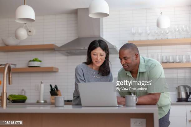 husband and wife working on taxes - loan stock pictures, royalty-free photos & images