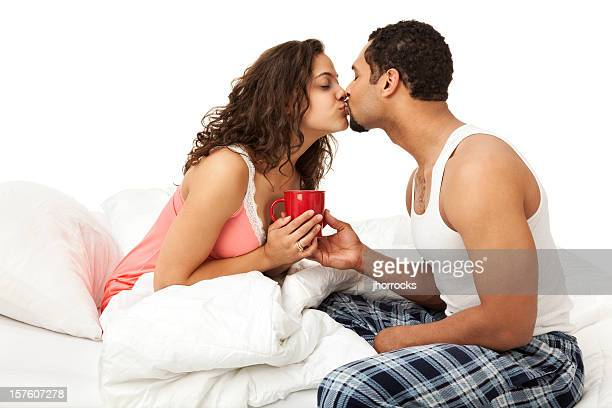Husband Bringing Wife Coffee in Bed