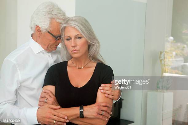 husband consoling his sad wife - wife stock pictures, royalty-free photos & images