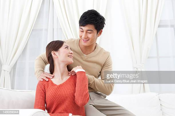 husband doing message for his wife - massage parlour stock photos and pictures