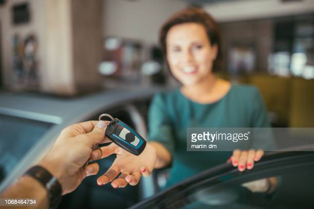 husband giving the car keys from new car to his wife - test drive stock pictures, royalty-free photos & images