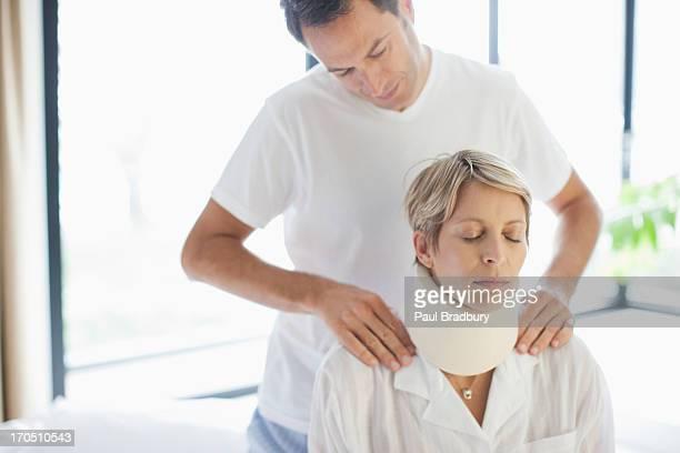 Husband helping wife in neck brace