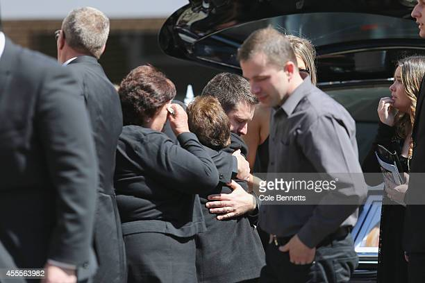 Husband John O'Brien embraces family a family member at a service to remember Bianka O'Brien and her 11month old son Jude who where killed on...