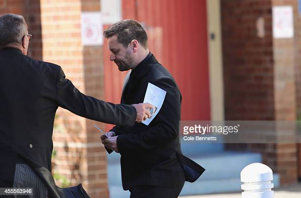 Husband John O'Brien is comforted by the Funeral Director at a service to remember Bianka O'Brien and her 11month old son Jude who where killed on...