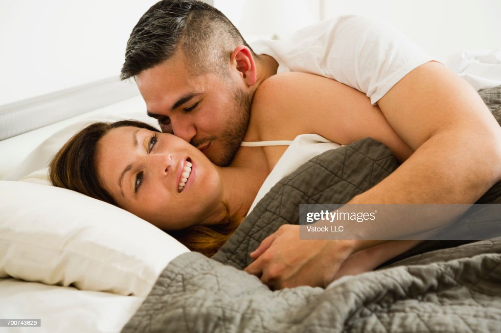 Husband Kissing Wife In Morning Stock Photo