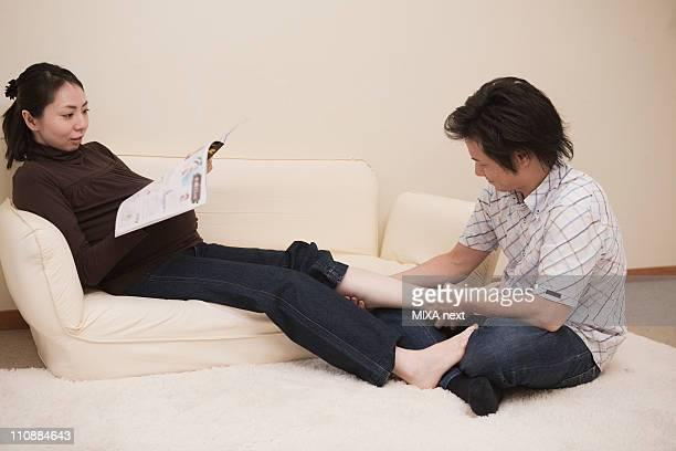 Husband Massaging Pregnant Wife