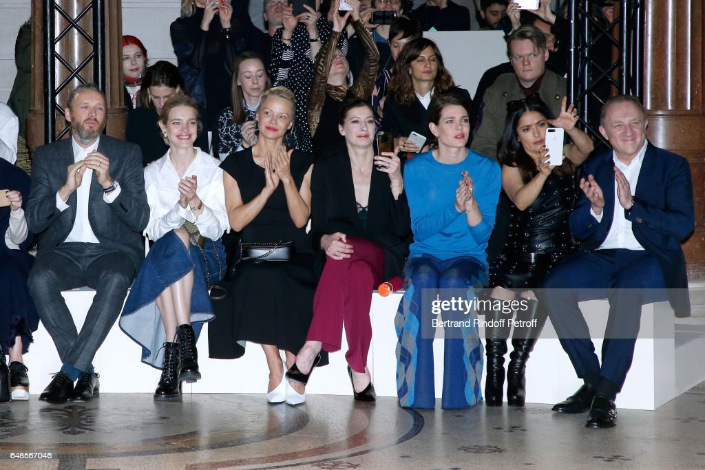 Husband of Stella, Alasdhair Willis, Natalia Vodianova, Pamela Anderson, Marie-Agnes Gillot, Charlotte Casiraghi, Salma Hayek and her husband CEO of Kering Group, Francois-Henri Pinault attend the Stella McCartney show as part of the Paris Fashion Week Womenswear Fall/Winter 2017/2018 on March 6, 2017 in Paris, France.