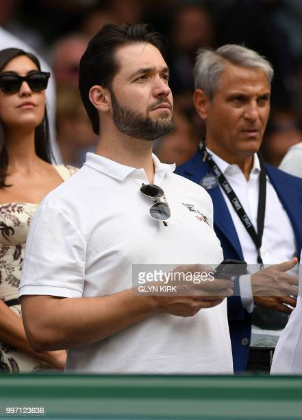 Husband of US player Serena Williams Alexis Ohanian takes his seat on court to watch her play against Germany's Julia Goerges during their women's...