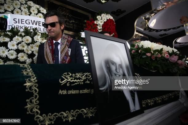 Husband Sinan Urfali of Burcu Gundogar Urfali mourns over her coffin during the funeral ceremony at the Atakoy 5th Section Mosque in Istanbul Turkey...