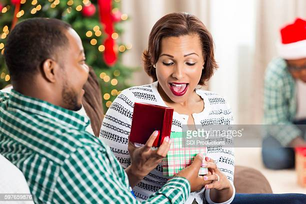 Husband surprises wife with Christmas gift