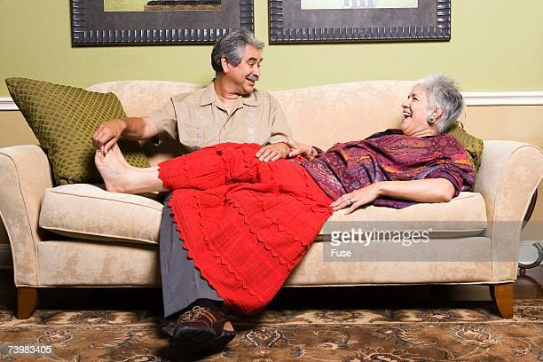 husband tickling wife's feet - tickling feet stock photos and pictures