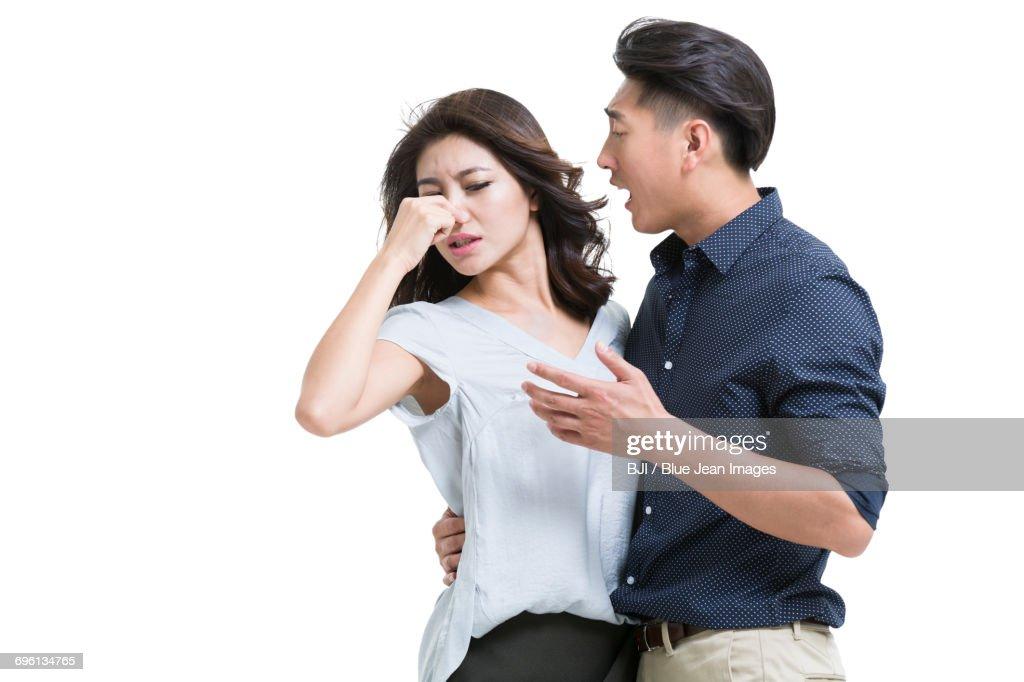Husband with bad breath : Stock Photo