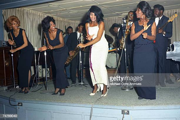 Husbandandwife RB duo Ike Tina Turner perform onstage with a Fender Stratocaster electric guitar and the Ikettes in 1964 in Dallas Fort Worth Texas