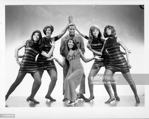 Husbandandwife RB duo Ike Tina Turner pose for a portrait with their back up dancers The Ikettes in circa 1971