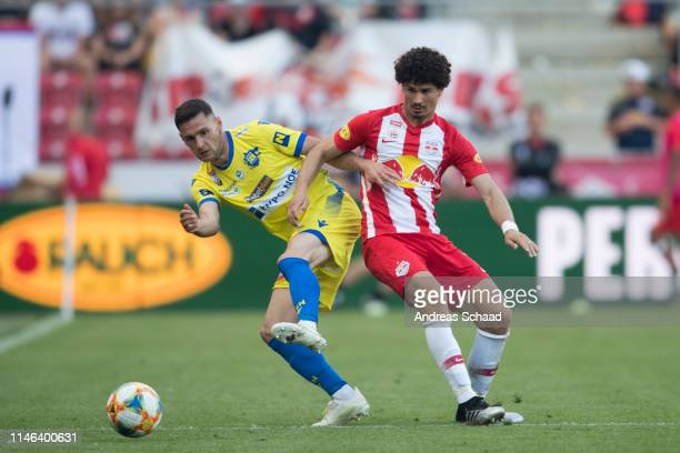 Husein Balic of St. Poelten and Andre Ramalho of Salzburg in action during the tipico Bundesliga match between RB Salzburg and SKN St. Poelten at Red...