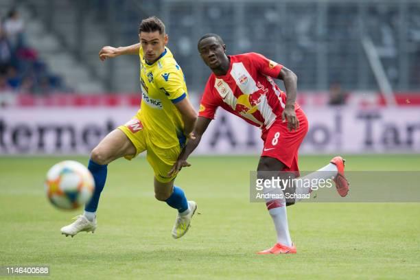 Husein Balic of St Poelten in action against Diadie Samassekou of Salzburg during the tipico Bundesliga match between RB Salzburg and SKN St Poelten...