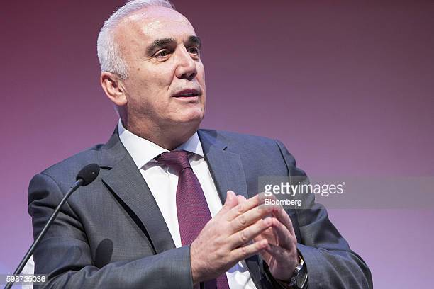 Huseyin Aydn chief executive officer of TC Ziraat Bankasi AS gestures as he speaks on a panel during the BloombergHT investor conference in Istanbul...
