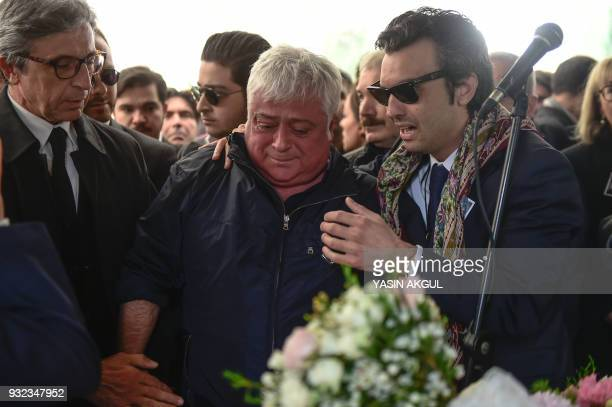 Huseyin Basaran father of Mina Basaran one of the victims of a a plane crash over Iran mourn next to her coffin on March 15 2018 during her funeral...