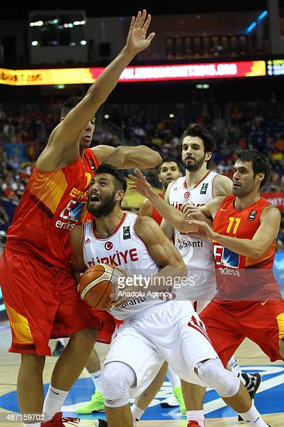 Huseyin Koksal of Turkey vies for the ball during the FIBA EuroBasket 2015 Group B basketball match between Turkey and Spain at Mercedes Benz Arena...