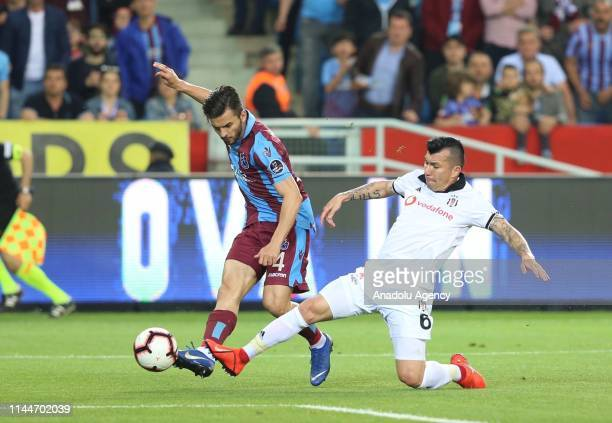 Huseyin Turkmen of Trabzonspor in action against Medel of Besiktas during Turkish Super Lig soccer match between Trabzonspor and Besiktas at the...