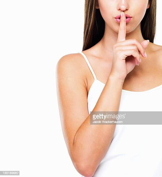 hush - finger on lips stock pictures, royalty-free photos & images