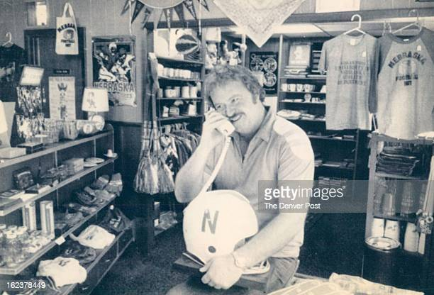 SEP 1982 SEP 1983 SEP 10 1983 SEP 11 1983 Husker RahRahSteve Briggs proprietor of the Husker Corner in Omaha is shown here with helmet telephoneone...