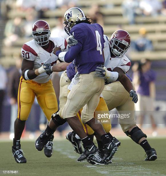 Huskies quarterback Isaiah Stanback is sacked during the game between the USC Trojans and the University of Washington Huskies at Husky Stadium in...