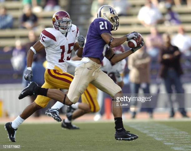 Huskies Sonny Shackelford makes a big reception over the defense of Trojans Kevin Thomas during the game between the USC Trojans and the University...