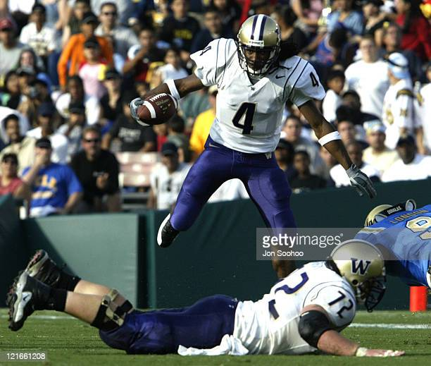 Husky Isaiah Stanback jumps over teammate Todd Bachert in the second quarter at the Rose Bowl UCLA beat Washington 4616