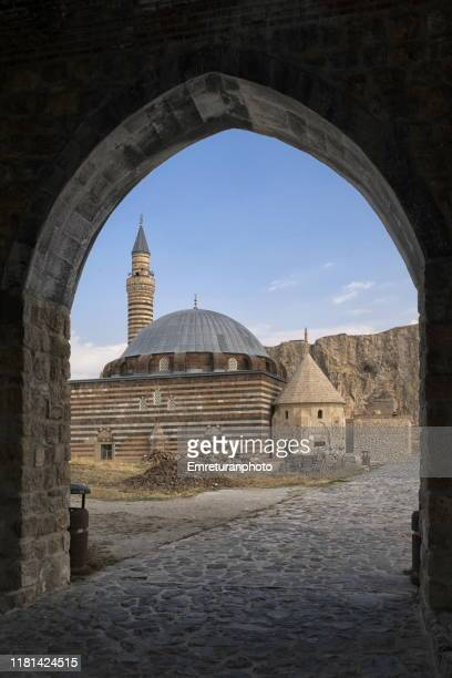 husrev pasa mosque view through the entrance gate of old van city walls. - emreturanphoto stock pictures, royalty-free photos & images
