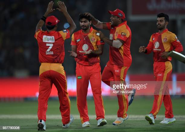 Hussain Talat of Islamabad United celebrates with teammates after taking a catch to dismiss Saad Nasim of Peshawar Zalmi during the Pakistan Super...